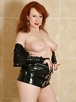 Busty mature redhead wears kinky latex lingerie and boots