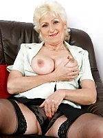 Well endowed grandma is massaging her tits and pussy with lube
