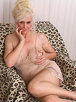 Over 60 granny in stockings spreads her hairy pussy
